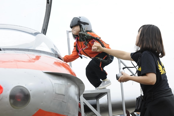 A young Korean girl climbs into a T-37 Tweety aircraft at the Sacheon Airshow at Sacheon Base, Republic of Korea, Oct. 20, 2016. 7th Air Force provided both an F-16 and A-10 Thunderbolt II static display for the four-day airshow, showcasing U.S. Air Force capabilities to over 260,000 attendees. (U.S. Air Force photo by 1st Lt. Lauren Linscott/Released)