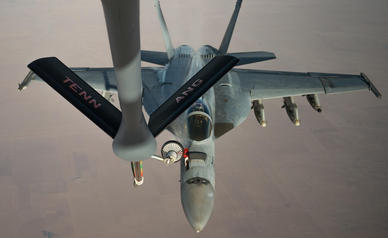 A U.S. Navy F/A-18 Super Hornet receives fuel from a KC-135 Stratotanker over Iraq in support of Operation Inherent Resolve Oct 17, 2016. The operational mission of Operation Inherent Resolve is to militarily defeat Da'esh in the Combined Joint Operation Area in order to enable whole-of-coalition governmental actions to increase regional stability. (U.S. Air Force photo by Staff Sgt. Douglas Ellis/Released)