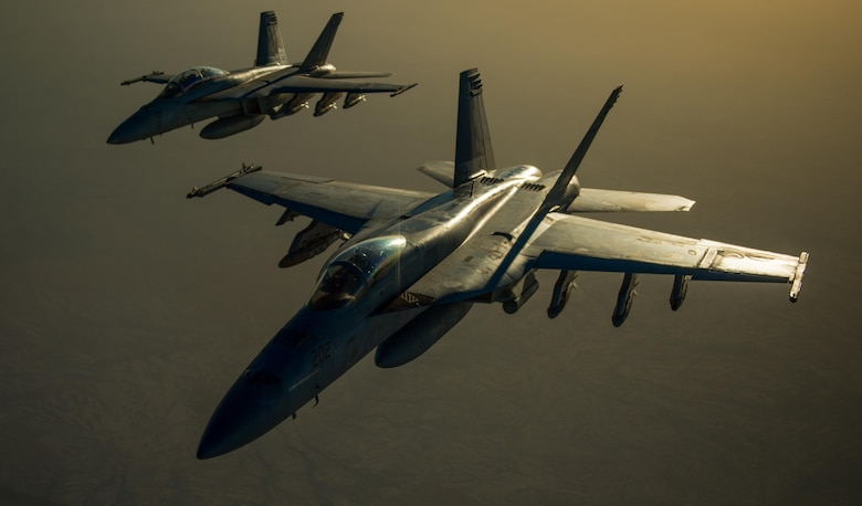 Two U.S. Navy F/A-18 Super Hornets fly in formation after receiving fuel from a KC-135 Stratotanker over Iraq in support of Operation Inherent Resolve Oct 17, 2016. The operational mission of Operation Inherent Resolve is to militarily defeat Da'esh in the Combined Joint Operation Area in order to enable whole-of-coalition governmental actions to increase regional stability. (U.S. Air Force photo by Staff Sgt. Douglas Ellis/Released)