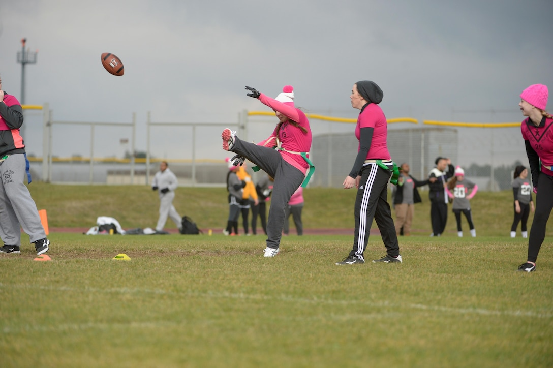 Airmen and family members from the 52nd Fighter Wing participated in a flag football game at the 2016 Combined Federal Campaign-Overseas kickoff Oct. 15, 2016, at Spangdahlem Air Base, Germany. The campaign offers people an opportunity to donate money to more than 2,600 national, international and public philanthropic organizations. (U.S. Air Force photo by Staff Sgt. Jonathan Snyder)