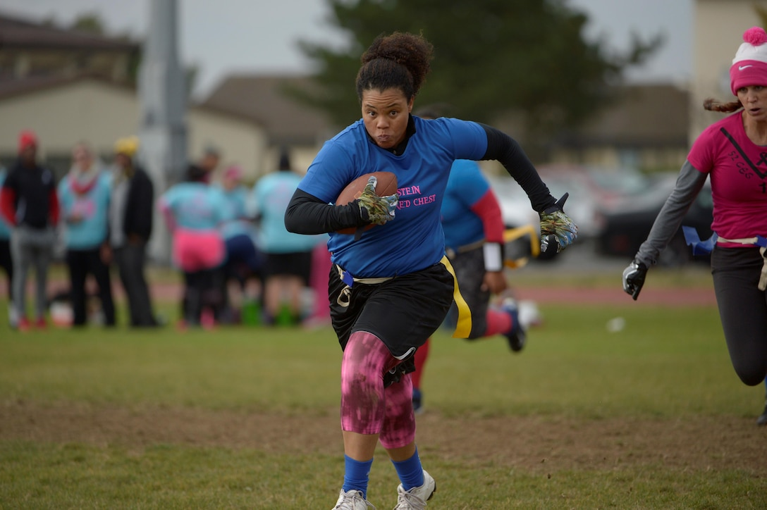 Airmen and family members from the 52nd Fighter Wing participated in a flag football game at the 2016 Combined Federal Campaign-Overseas kickoff Oct. 15, 2016, at Spangdahlem Air Base, Germany. CFC has more than 200 campaigns throughout the world to help to raise millions of dollars for eligible non-profit organizations each year. (U.S. Air Force photo by Staff Sgt. Jonathan Snyder)