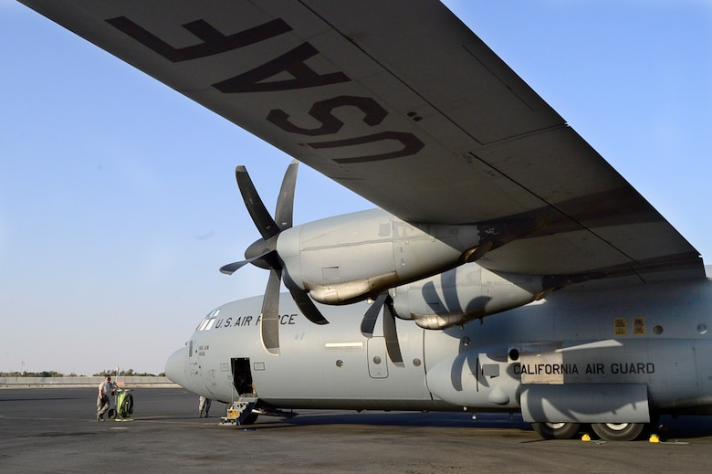 A C-130J Super Hercules assigned to the 737th Expeditionary Airlift Squadron sits on the ramp at an undisclosed location in Southwest Asia prior to a mission to Qayyarrah West Airfield, Iraq, Oct. 21, 2016. The 737th EAS flew the first coalition mission into the airfield since the start of Operation Inherent Resolve. (U.S. Air Force photo by Staff Sgt. Aaron Richardson/Released)