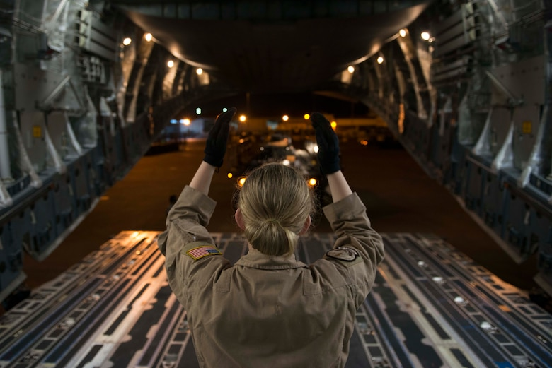 U.S. Air Force Airman 1st Class Tayler Gardner, 7th Airlift Squadron loadmaster, guides a 60K loader toward the back of a C-17 Globemaster III Oct. 21, 2016, at Incirlik Air Base, Turkey. Loadmasters supervise the loading and unloading of cargo and personnel on the aircraft. (U.S. Air Force photo by Senior Airman John Nieves Camacho)