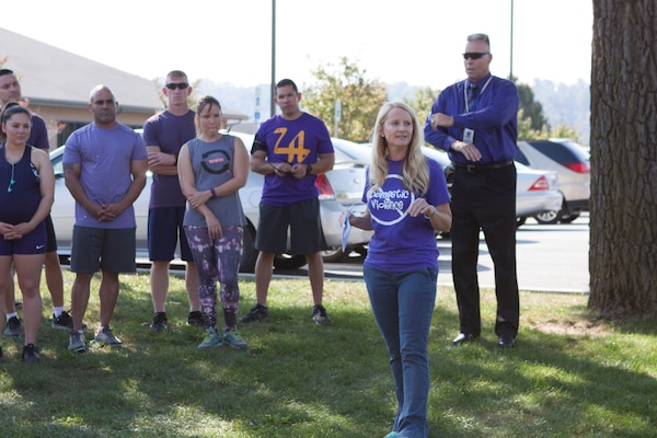 A.J. Brandt, DLA Distribution's sexual assault response coordinator gives opening remarks before the Domestic Violence Awareness 5K Fun Run and two-mile walk kicks off.
