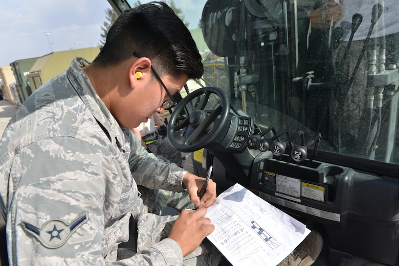 U.S. Air Force Airman Kyle George, 728th Air Mobility Squadron air transportation journeyman, annotates cargo weight on a load plan Oct. 18, 2016, at Incirlik Air Base, Turkey. The load plan contains information such as tracking numbers, cargo quantity and weight. (U.S. Air Force photo by Senior Airman John Nieves Camacho)