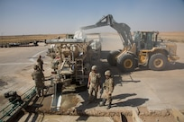 A U.S. Airman pours dry concrete into a volumetric mixer during runway repair operations at Qayyarah West airfield, Iraq, Oct. 9, 2016. The 1st Expeditionary Civil Engineering Group has been tasked to repair the runway after The Islamic State of Iraq and the Levant (ISIL) destroyed it to disrupt Coalition forces from gaining control in the area. A Coalition of regional and international nations have joined together to enable Iraqi forces to counter ISIL, reestablish Iraq's borders and re-take lost terrain thereby restoring regional stability and security.  (U.S. Army photo by Spc. Christopher Brecht)