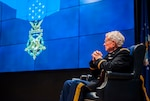 Army Lt. Col. Charles Kettles (Ret.) on stage during a visit to DLA Land and Maritime Oct. 19. Kettles was awarded the Medal of Honor July 18 for actions he performed as a helicopter pilot in Vietnam, during which he saved the lives of 44 men.