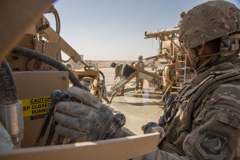 A U.S. Airman assigned to the 1st Expeditionary Civil Engineering Group operates a volumetric mixer during runway repair operations at Qayyarah West airfield, Iraq, Oct.9, 2016. 1st ECEG has been tasked with repairing the runway after the Islamic State of Iraq and the Levant (ISIL) destroyed it by using heavy machinery and explosives to disrupt Coalition forces from gaining control in the area. A Coalition of regional and international nations have joined together to enable Iraqi forces to counter ISIL, reestablish Iraq's borders and re-take lost terrain thereby restoring regional stability and security.  (U.S. Army photo by Spc. Christopher Brecht)