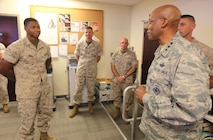 U.S. Air Force Lt. Gen. Charles Q. Brown, deputy commander, U.S. Central Command, speaks with U.S. Marine Sgt. Mathew Smith, an operations planner with U.S. Marine Corps Forces, Central Command, aboard AFB MacDill, Tampa, Fla., Oct. 4.   Brown visited the MARCENT headquarters for a brief by its commander, Lt. Gen. William D. Beydler (center) and a tour of the facility.  Smith was recognized by the CENTCOM leader for his superior performance on the job, his pursuit of a college degree, and the selfless hours of community service he has given.  (U.S. Marine Corps photo by Master Sgt. Will Price)