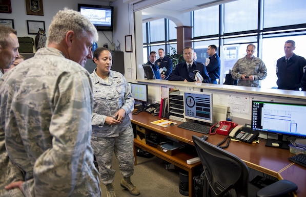 Tech. Sgt. April Owens, 89th Operations Support Squadron's Weather Flight training manager, explains the equipment used to track weather to Lt. Gen. Sam Cox, 18th Air Force commander, on Joint Base Andrews, Md., Oct. 19, 2016. During his visit to the 89th Airlift Wing, Cox also toured flight planning, the snow cab and the airfield. Cox visited the 89th AW to thank Airmen for the jobs they do in support of U.S. rapid global mobility and to stress the importance of their mission. (U.S. Air Force photo/Senior Airman Ryan J. Sonnier/Released)