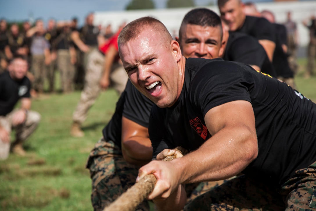 Second Lieutenant Tyler R. Watkins leads Delta Company during a field meet at Officer Candidates School, aboard Marine Corps Base Quantico, Va., Aug. 4, 2016. Once an NCAA Division I athlete, Watkins transitioned from trying to play football professionally to his dreams of becoming a Marine officer. He graduated OCS with Officer Candidate Class 222, which had the most OCS graduates since 2009, on Aug. 6, 2016. Due to injuries sustained during OCS, he is temporarily assigned to the Plans and Research section at Marine Corps Recruiting Command aboard MCB Quantico. Watkins hopes to return to training in March 2017.