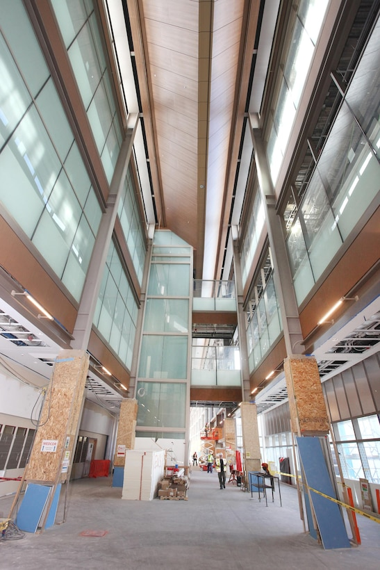 The quarter-mile long Concourse at the Department of Veteran Affairs Replacement Medical Center that is under construction in Aurora, Colorado serves as a central connector for clinic buildings, diagnostic and treatment centers, in-patient buildings, a chapel, and more. When complete, the 1.2 million square-foot and three parking garages with 2,242 spaces will serve more than 400,000 veterans and their families in the Colorado area.