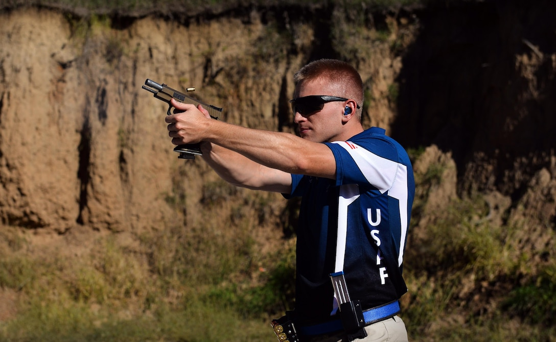 U.S. Air Force 2nd Lt. Casey Ryan, 55th Security Forces Squadron Officer-in-Charge of Logistics, fires his competition .40 caliber STI Eagle at targets set up in a berm at the Eastern Nebraska Gun Clun on Sept. 28 in Louisville, Neb.  The pistol is one of three guns Ryan uses when he represent the U.S. Air Force in shooting contests.  (U.S. Air Force photo by Josh Plueger)
