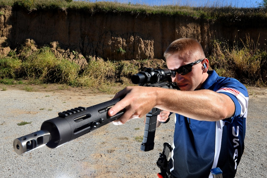 U.S. Air Force 2nd Lt. Casey Ryan, 55th Security Forces Squadron Officer-in-Charge of Logistics, takes aim at knockdown plate targets set up at the Eastern Nebraska Gun Club on Sept. 28 in Louisville, Neb.  Ryan is a part of the official Air Force competition shooting team.  (U.S. Air Force photo by Josh Plueger)