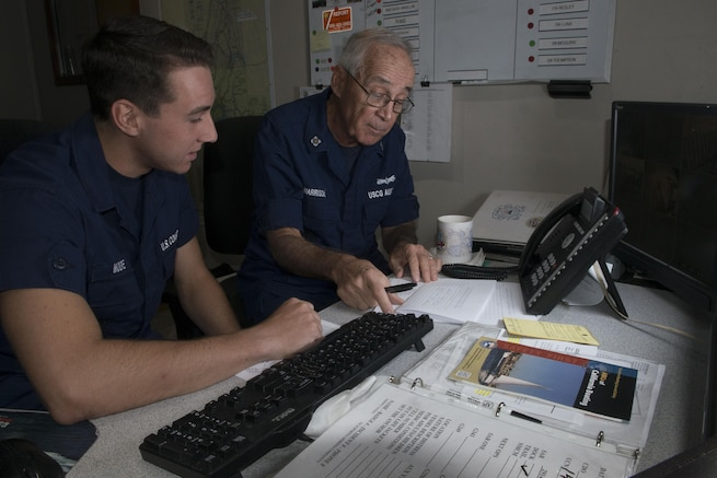 An Auxiliarist conducts communication watchstander at Coast Guard Station Rio Vista. Station Rio Vista's