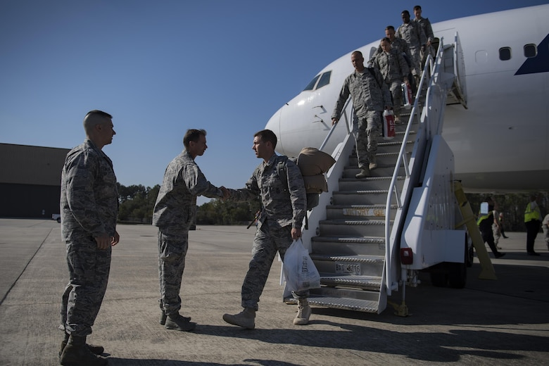 Airmen assigned to the 822d Base Defense Squadron are greeted by Col. Bradley Smith, 93d Air Ground Operations Wing vice commander, and Col. Kevin Walker, 820th Base Defense Group commander, Oct. 21, 2016, at Moody Air Force Base, Ga. These Airmen were tasked with securing expeditionary stations and assets in Southwest Asia. (U.S. Air Force photo by Airman 1st Class Daniel Snider)