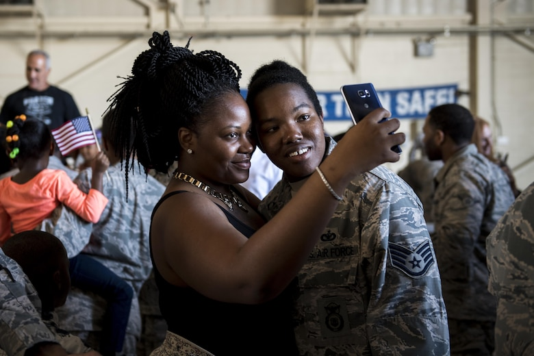 Staff Sgt. Brandi Johnson, 822d Base Defense Squadron security forces member, poses for a selfie with a loved one after returning from a deployment to Southwest Asia, Oct. 21, 2016, at Moody Air Force Base, Ga. The 822d BDS maintains readiness to deploy at a moment's notice by upholding all combat and specialty training standards. (U.S. Air Force photo by Airman 1st Class Daniel Snider)