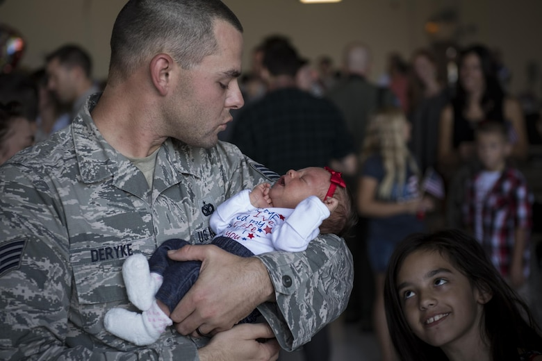 Staff Sgt. Brandon Deryke, 822d Base Defense Squadron NCO in charge of combat arms, greets his family after returning from a deployment to Southwest Asia, Oct. 21, 2016, at Moody Air Force Base, Ga. The 822d is one of three base defense squadrons stationed at Moody that cycles through rotational deployments to secure overseas assets. (U.S. Air Force photo by Airman 1st Class Daniel Snider)