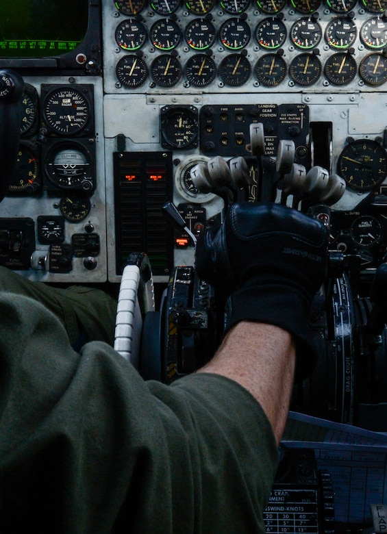 Capt. Lance Adsit, 20th Bomb Squadron aircraft commander, presses forward on the throttles of a B-52 Stratofortress during an integration flight above the Gulf of Mexico Oct. 13, 2016. The integration was the capstone event of a six-month training course, involving extensive communication planning across more than 10 agencies within the bomber community, followed by a live-fly exercise with two B-1 Lancers from Dyess Air Force Base, Texas, and two B-52s from Barksdale. U.S. Air Force photo/Senior Airman Curt Beach)