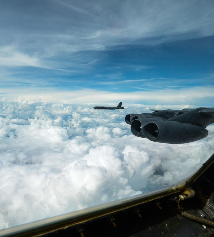 From the cockpit of a B-52 Stratofortress from Barksdale Air Force Base, La., a fellow B-52 can be seen flying over the Gulf of Mexico Oct. 13, 2016. The B-52s were participating in an integration exercise between Barksdale's 340th Weapons School and the 77th Weapons School, Dyess Air Force Base, Texas. The integration was the capstone event of a six month training course, involving extensive communication planning across more than 10 agencies within the bomber community, followed by a live fly exercise. (U.S. Air Force photo/Senior Airman Curt Beach)