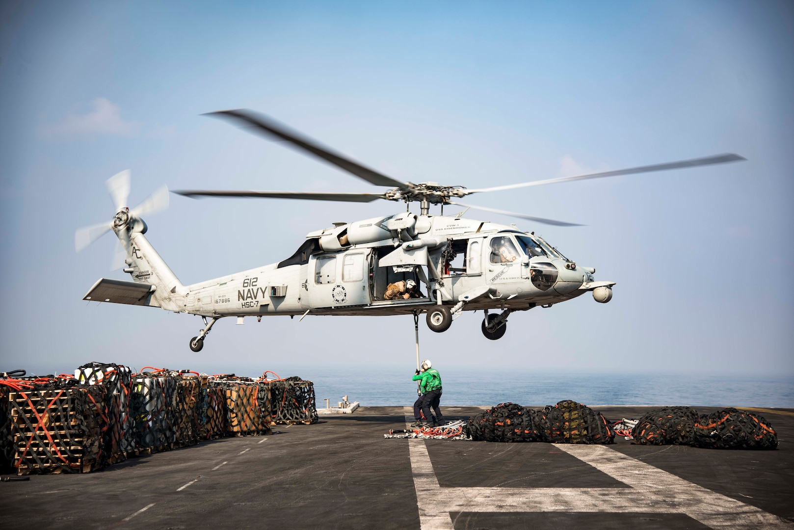 161021-N-BH414-247  ARABIAN GULF (Oct. 21, 2016) An MH-60S Sea Hawk helicopter assigned to the Dusty Dogs of Helicopter Sea Combat Squadron (HSC) 7 picks up cargo nets on the flight deck of the aircraft carrier USS Dwight D. Eisenhower (CVN 69) (Ike) during a replenishment-at-sea with the fleet replenishment oiler USNS Pecos (T-AO 197). Ike and its Carrier Strike Group are deployed in support of Operation Inherent Resolve, maritime security operations and theater security cooperation efforts in the U.S. 5th Fleet area of operations. (U.S. Navy photo by Seaman Casey S. Trietsch)
