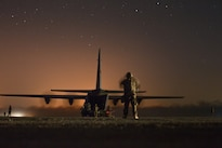 An Air Force C-130J Super Hercules waits to unload logistical supplies in support of the fight for Mosul at Qayyarah West Airfield, Iraq, Oct. 22, 2016. Control of the airfield has enabled the opening of an air corridor to support operations throughout northern Iraq. Army photo by Spc. Christopher Brecht