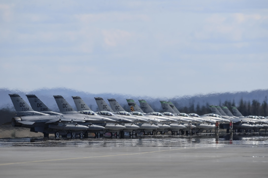 U.S. Air Force F-16 Fighting Falcon aircraft assigned to the 121st Fighter Squadron (FS), Joint Base Andrews, Md., and the 112th FS, Toledo Air National Guard Base, Ohio, stand by for launch May 4, 2015, during RED FLAG-Alaska (RF-A) 15-2 at Eielson Air Force Base, Alaska.  (U.S. Air Force photo by Senior Airman Peter Reft/Released)