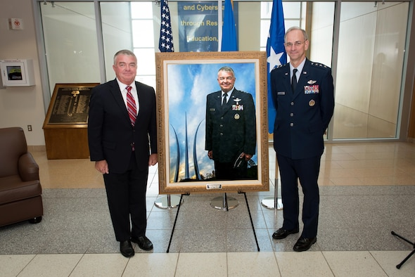 "Lt. Gen. (ret) Thomas W. Travis (left), who served as the 21st Surgeon General of the United States Air Force, and Lt. Gen. Mark A. Ediger, current Air Force Surgeon General, unveil a portrait of Travis to hang in the United States Air Force School of Aerospace Medicine during a ceremony here Oct. 24, 2016. The School -- part of the Air Force Research Laboratory's 711th Human Performance Wing -- displays portraits of all past Air Force Surgeons General. Travis served in the role from July 2012 until June 2015, and also served as the School's commander from July 2001 to February 2003. ""I'm very, very proud of my history with the School,"" Travis said at the ceremony, ""during my times as a student, my time as commander and my time as the surgeon general. ""The School has a bright future, and I look forward to seeing how they continue to accomplish their tremendous mission."" (U.S. Air Force photo/Rick Eldridge)"