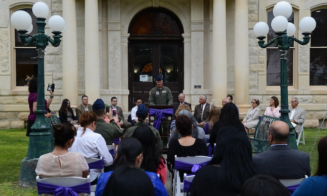 Col. Thomas Shank, 47th Flying Training Wing commander, speaks to a crowd at the Val Verde County Courthouse in Del Rio, Texas, Oct. 13, 2016. This event launched the Val Verde County Sexual Assault Response Team, which will allow victims to receive all initial care and response in Del Rio instead of having to seek aid San Antonio, Texas. (U.S. Air Force photo/Senior Airman Ariel D. Partlow)