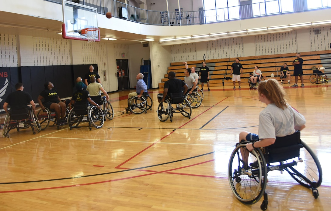As part of National Disability Employment Awareness Month, Robins hosted a wheelchair basketball clinic and games Oct. 20. The Fort Benning Warrior Transition Battalion demonstrated how to play wheelchair basketball and also provided tips and techniques to those participating. Numerous games were played to ensure everyone had a chance to participate and learn the game of wheelchair basketball. The Henry County Parks and Recreation provided the wheelchairs for participants. (U.S. Air Force photo by Ray Crayton)