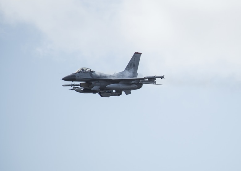 AOMORI, Japan - An F-16 Fighting Falcon soars in the sky during a Range Day event at Misawa Air Base, Japan, Oct. 21, 2016.  The F-16 is a compact, multi-role fighter aircraft that is high  maneuverable and has proven itself in air-to-air and air-to-surface attacks.