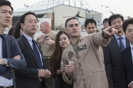 Yoshihiko Fukuda, mayor of Iwakuni City, Japan, and U.S. Marine Corps Lt. Col. J. T. Bardo, commanding officer of Marine Fighter Attack Squadron (VMFA) 121, observe an F-35B Lightning II at Marine Corps Air Station (MCAS) Yuma, Arizona, Oct. 24, 2016. The demonstration of the F-35B gave Fukuda a better understanding of the aircraft and its capabilities. This event helped Fukuda better understand the capabilities of VMFA 121.(U.S. Marine Corps photo by Cpl. Nathan Wicks)