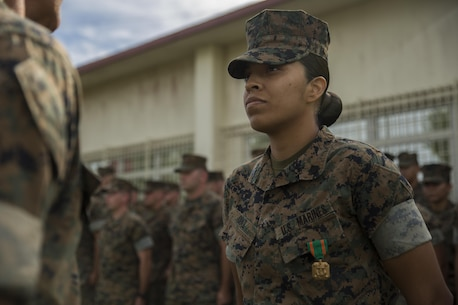 U.S. Marine Sgt. Alexeandra Diaz receives a Navy and Marine Corps Achievement Medal during an awards ceremony held on Camp Courtney, Okinawa, after the end of Philippine Amphibious Landing Exercise 33 (PHIBLEX), Oct. 20, 2016. PHIBLEX is an annual U.S.-Philippine military bilateral exercise that combines amphibious capabilities and live-fire training with humanitarian civic assistance efforts to strengthen interoperability and working relationships. Diaz is with 3d Marine Expeditionary Brigade. (U.S. Marine Corps photo by Sgt. Kathy Nunez/Released)