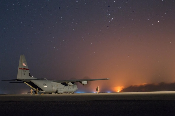 A U.S. Air Force C-130J Super Hercules waits to unload logistical supplies in support of the fight for Mosul at Qayyarah West airfield, Iraq, Oct. 22, 2016. This is the second aircraft to land there following completion of repairs to the runway after Da'esh damaged it in an attempt to disrupt Iraqi Security forces from gaining control of the area. Control of the Qayyarah West airfield has enabled the opening of an air corridor to support operations throughout northern Iraq. A Coalition of over 60 nations has formed to provide assistance and training to Iraqi forces to counter Da'esh, re-establish Iraq's borders and re-take lost terrain thereby restoring regional stability and security.  (U.S. Army photo by Spc. Christopher Brecht)