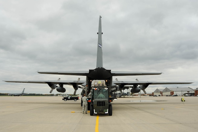 Airmen from the 127th Logistics Readiness Squadron load a C-130 Hercules at Selfridge Air National Guard Base, Mich., Oct. 21, 2016. The aircraft is from the 302nd Airlift Wing, Air Force Reserve, Peterson AFB, Colo. The Air Force personnel are loading what's known as a Denton Cargo shipment -- a movement of humanitarian supplies allowed under U.S. law utilizing military assets. The supplies -- a rice and soy-based dehydrated meal mix created by Michigan-based charity Kids Against Hunger, are to be delivered to an organization in Guatemala. (U.S. Air National Guard photo by John Brandenburg)
