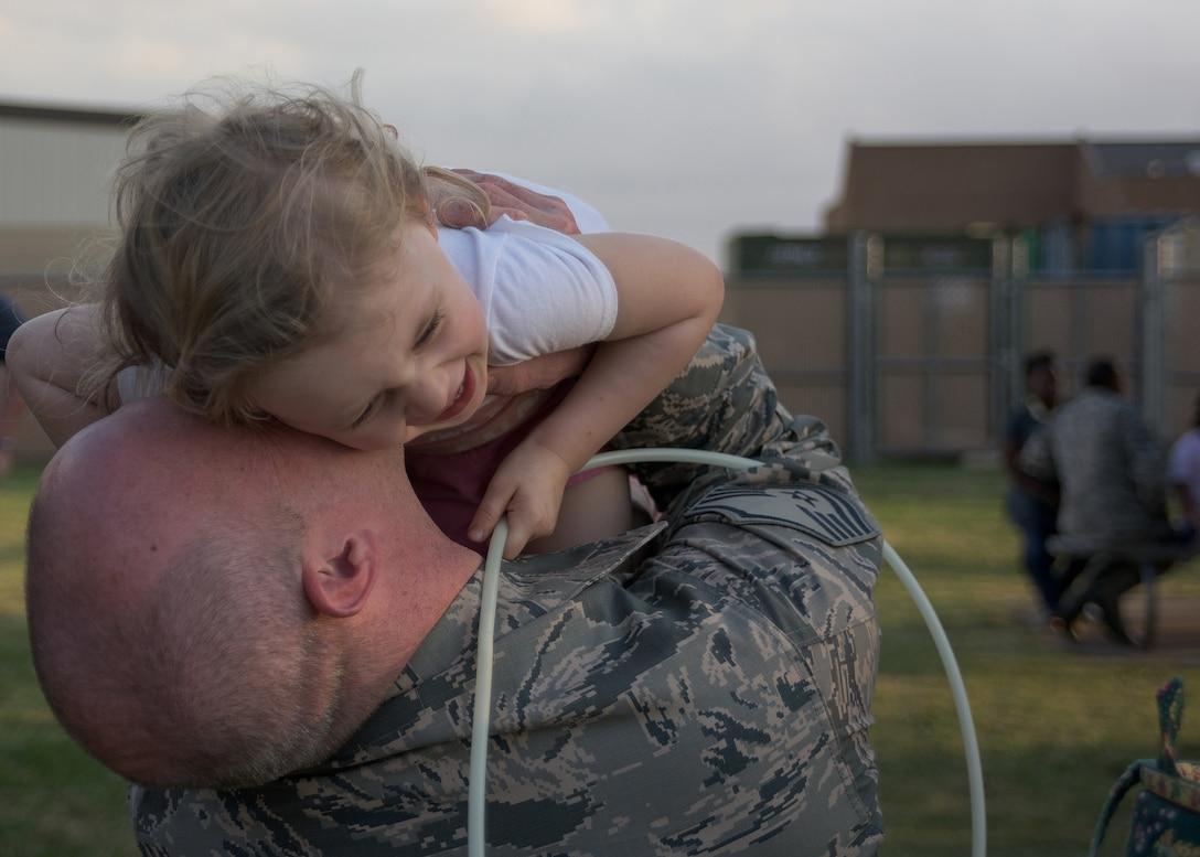 Air Force Master Sgt. Michael Rigsby assigned to the 137th Special Operations Civil Engineering Squadron, spends time with his daughter prior to deploying from Will Rogers Air National Guard Base, October 19, 2016. Rigsby is one of over 140 Airmen who will deploy from WRANGB in support of Operation Freedom's Sentinel in Southwest Asia, the first major deployment for the 137 SOW as a special operations wing. (U.S. Air National Guard photo by Tech. Sgt. Caroline Essex)