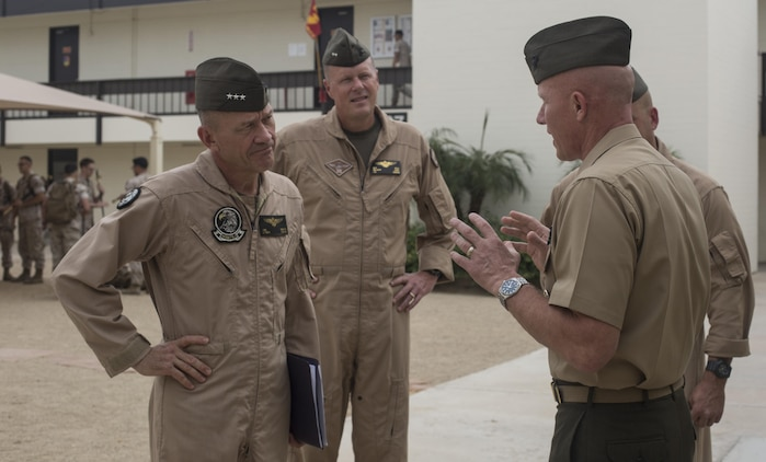 From left to right, U.S. Marine Corps Lt. Gen. Jon Davis, deputy commandant for aviation, Maj. Gen. Mark Wise, 3rd Marine Aircraft Wing (MAW) commanding general, are greeted by Col. Richard Fuerst, commanding officer of Marine Corps Air Station (MCAS) Iwakuni, Japan, at MCAS Yuma, Ariz. Oct. 24, 2016. This event gave Yoshihiko Fukuda, mayor of Iwakuni City, Japan, an idea of what to expect of the aircraft following the scheduled basing of Marine Fighter Attack Squadron (VMFA) 121 at MCAS Iwakuni. After its transition, VMFA-121 will be the first F-35B squadron stationed in Japan.(U.S. Marine Corps photo by 1st Lt. Melissa Heisterberg)