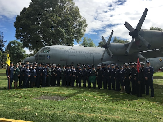 Military members from the United States Air Force and Colombian military stand in front of an aircraft Aug. 25, 2016 at the Colombian Air Mobility Command Headquarters in Bogota, Colombia. The service members recently completed Interamerican Squadron Officer School and the Interamerican Noncommissioned Officer Academy. (Courtesy Photo)
