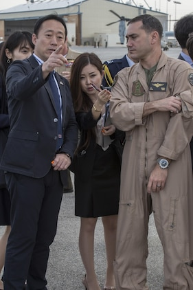 Yoshihiko Fukuda, mayor of Iwakuni City, Japan, and U.S. Marine Corps Lt. Col. J. T. Bordo, commanding officer of Marine Fighter attack Squadron (VMFA) 12 observes an F-35B Lightning II at Marine Corps Air Station (MCAS) Yuma, Arizona, Oct. 24, 2016. The demonstration of the F-35B gave Fukuda a better understanding of the aircraft and its capabilities. This event helped Fukuda better understand the capabilities of VMFA-121.(U.S. Marine Corps photo by Cpl. Nathan Wicks)