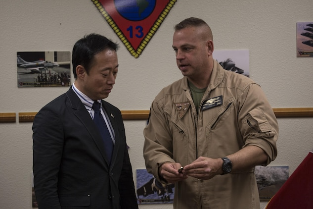 Yoshihiko Fukuda, mayor of Iwakuni City, Japan, and U.S. Marine Corps Col. Marcus Annibale, commanding officer of Marine Aircraft Group (MAG) 13 exchange gifts at Marine Corps Air Station (MCAS) Yuma, Arizona, Oct. 24, 2016. The demonstration of the F-35B gave Fukuda a better understanding of the aircraft and its capabilities. This event helped Fukuda better understand the capabilities of Marine Fighter Attack Squadron (VMFA) 121.(U.S. Marine Corps photo by Cpl. Nathan Wicks)
