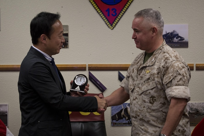 Yoshihiko Fukuda, mayor of Iwakuni City, Japan, and U.S. Marine Corps Col. Ricardo Martinez, commanding officer of Marine Corps Air Station (MCAS) Yuma, exchange gifts at MCAS Yuma, Arizona, Oct. 24, 2016. The demonstration of the F-35B gave Fukuda a better understanding of the aircraft and its capabilities. This event helped Fukuda better understand the capabilities of Marine Fighter Attack Squadron (VMFA) 121.(U.S. Marine Corps photo by Cpl. Nathan Wicks)