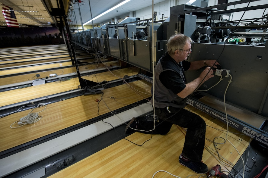 Dave Hardy, a contract worker, disassembles a pin-setter during a renovation at Eifel Lanes bowling center on Spangdahlem Air Base, Germany, Oct. 25, 2016. Renovations, like the bowling alley upgrade, are happening around the base in an effort to improve the quality of life for Airmen and their families. (U.S. Air Force Photo by Airman 1st Class Preston Cherry)