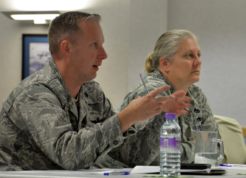U.S. Air Force Lt. Col. Benjamin Carroll, 100th Operations Support Squadron director of operations, and U.S. Air Force Lt. Col. Jennifer Neris, 100th Logistics Readiness Squadron commander, give their feedback during a professional development class Oct. 19, 2016, on RAF Mildenhall, England. Leadership took time to hear their Airmen's ideas, and then shared their thoughts. (U.S. Air Force photo by Gina Randall)