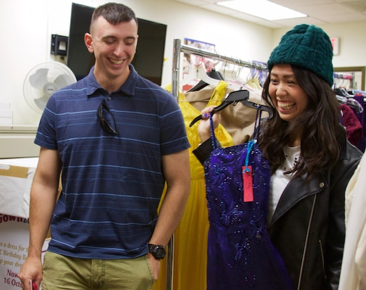 Daniel Ferris and his wife Chikako, are thrilled with the ball gown she found at the ExtravaGOWNza event, where there are donated dresses that spouses get to pick out and take home free.