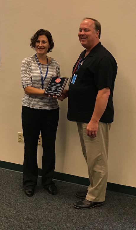 The USACE Tommy Schmidt National Dam Safety Professional of the Year Award for 2016 was presented to Dr. Georgette Hlepas (DSMMCX) on 19 October 2016 during the first quarter meeting of the USACE Dam Safety Steering Committee in Boston, MA.  The award is given annually to one deemed to have made the most significant contribution nationally to the USACE Dam Safety Program.