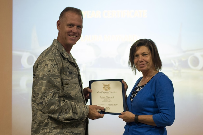 Laura Maynard 434th Force Support Squadron Staffing Specialist Right Receives A Certificate For