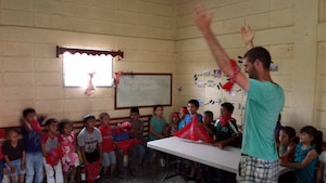 Army Reserve Pfc. Joshua Anderson, a service desk technician at the 335th Signal Command headquarters, teaches an English class to children in Siguatepeque, Honduras, during a recent volunteer mission a group of volunteers from his church. Courtesy photo