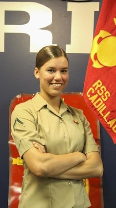 U.S. Marine Corps Pfc. Anne E. Lyman, a native of Traverse City, Michigan and recent Company honor graduate of Oscar Company, 4th Recruit Training Battalion, poses for a photo on Oct. 19, 2016 at Recruiting Substation Cadillac. Lyman is expected to report to Marine Combat Training in November where she will master basic infantry tactics to maintain combat readiness.  (U.S. Marine Corps photo by Cpl. Immanuel M. Johnson/Released)