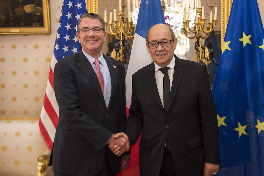 Defense Secretary Ash Carter poses for a photo with French Defense Minister Jean-Yves Le Drian.