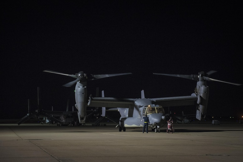20th Aircraft Maintenance Unit crew chiefs with the 727th Special Operations Aircraft Maintenance Squadron prepare to inspect a just-landed CV-22 Osprey Oct. 18, 2016 at Cannon Air Force Base, N.M. The 20th Aircraft Maintenance Unit is one of many shops at Cannon that operates 24 hours a day, keeping the 27th Special Operations Wing ready, relevant and resilient any time, any place. (U.S. Air Force Photo by Senior Airman Shelby Kay-Fantozzi/released)